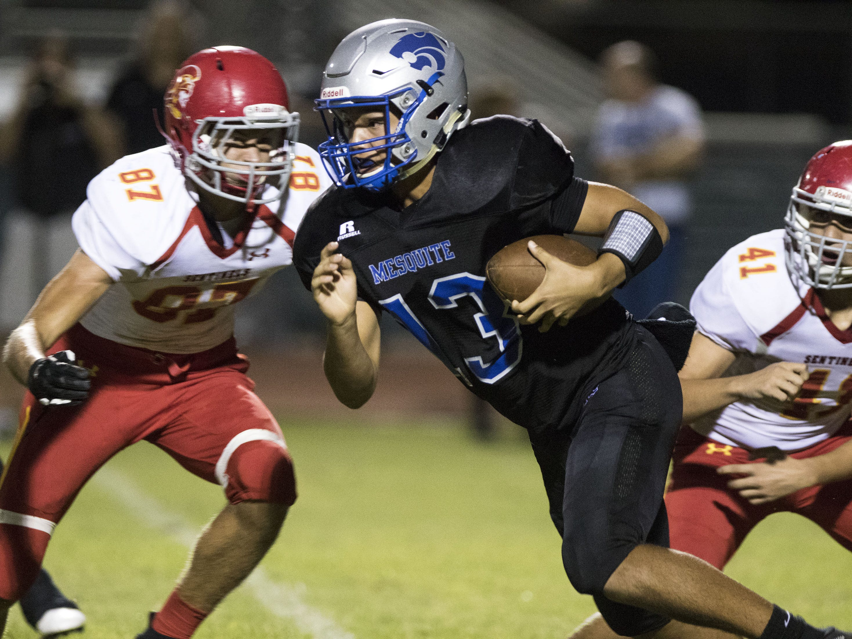 Mesquite's Ty Thompson looks for running room against Seton's defense during their game in Gilbert Friday, Sept. 21, 2018. #azhsfb
