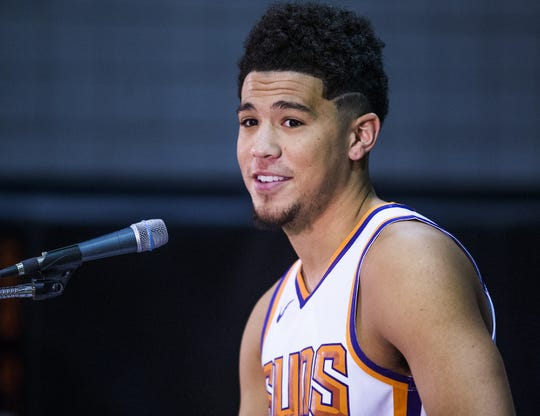 Devin Booker, guard for the Phoenix Suns, addresses the media at Phoenix Suns Media Day at Talking Stick Resort Arena in Phoenix, Monday, September 24, 2018.