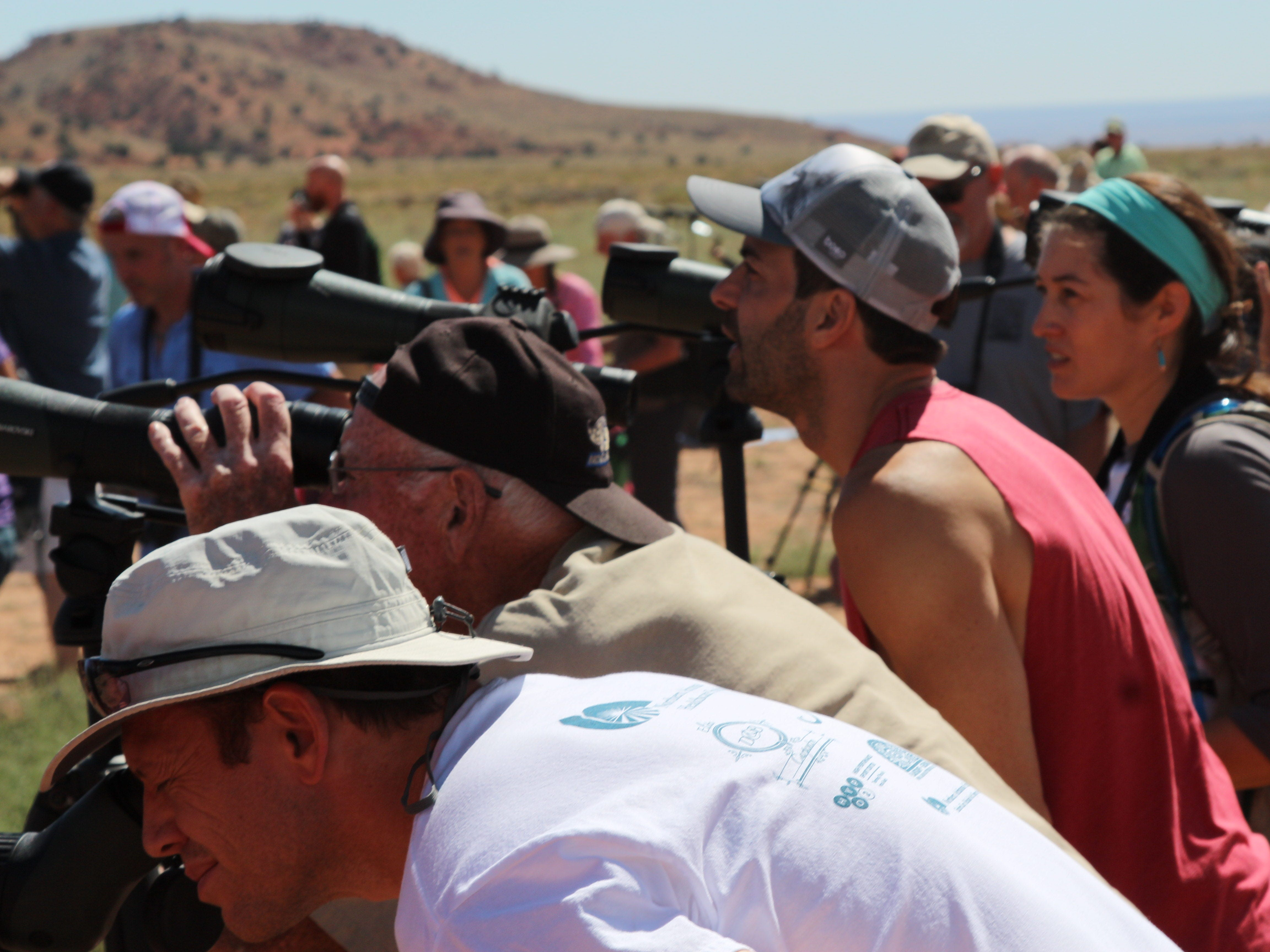 Visitors to Vermilion Cliffs National Monument peer through viewing scopes to look for California condors, newly released  into the wild on Sept. 22, 2018.