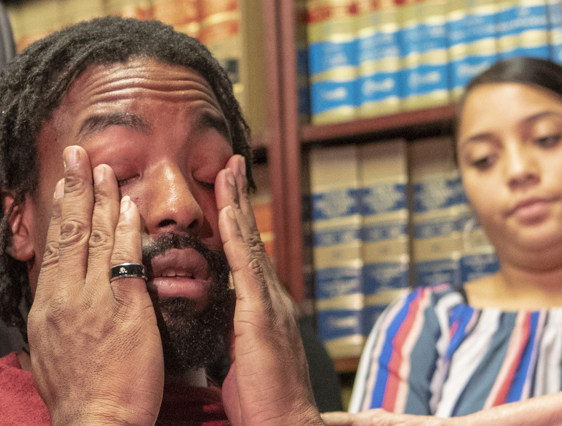 Edward Brown is paralyzed from the chest down after he was shot by a Phoenix police officer in August. Brown wipes his eyes at a press conference on Sept. 24, 2018.