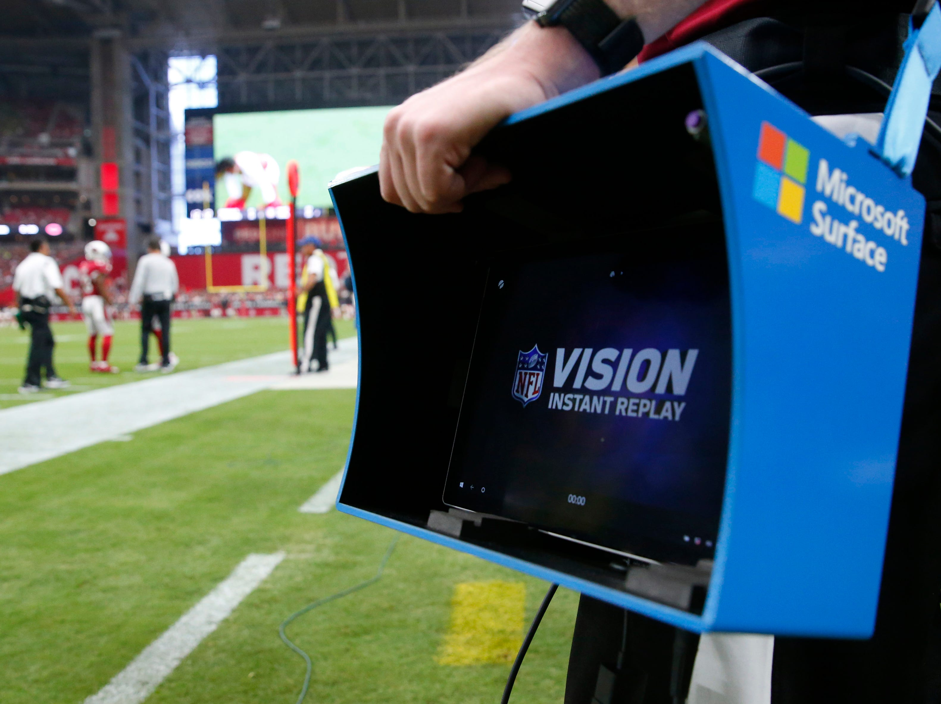 An official holds an instant replay monitor on the sidelines during the third quarter between the Arizona Cardinals and the Chicago Bears at State Farm Stadium in Glendale, Ariz. September 23, 2018.