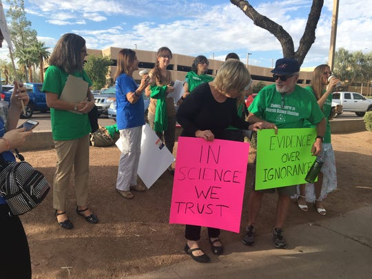 Protesters outside the Arizona Department of Education on Sept. 24, opposing revised science standards.