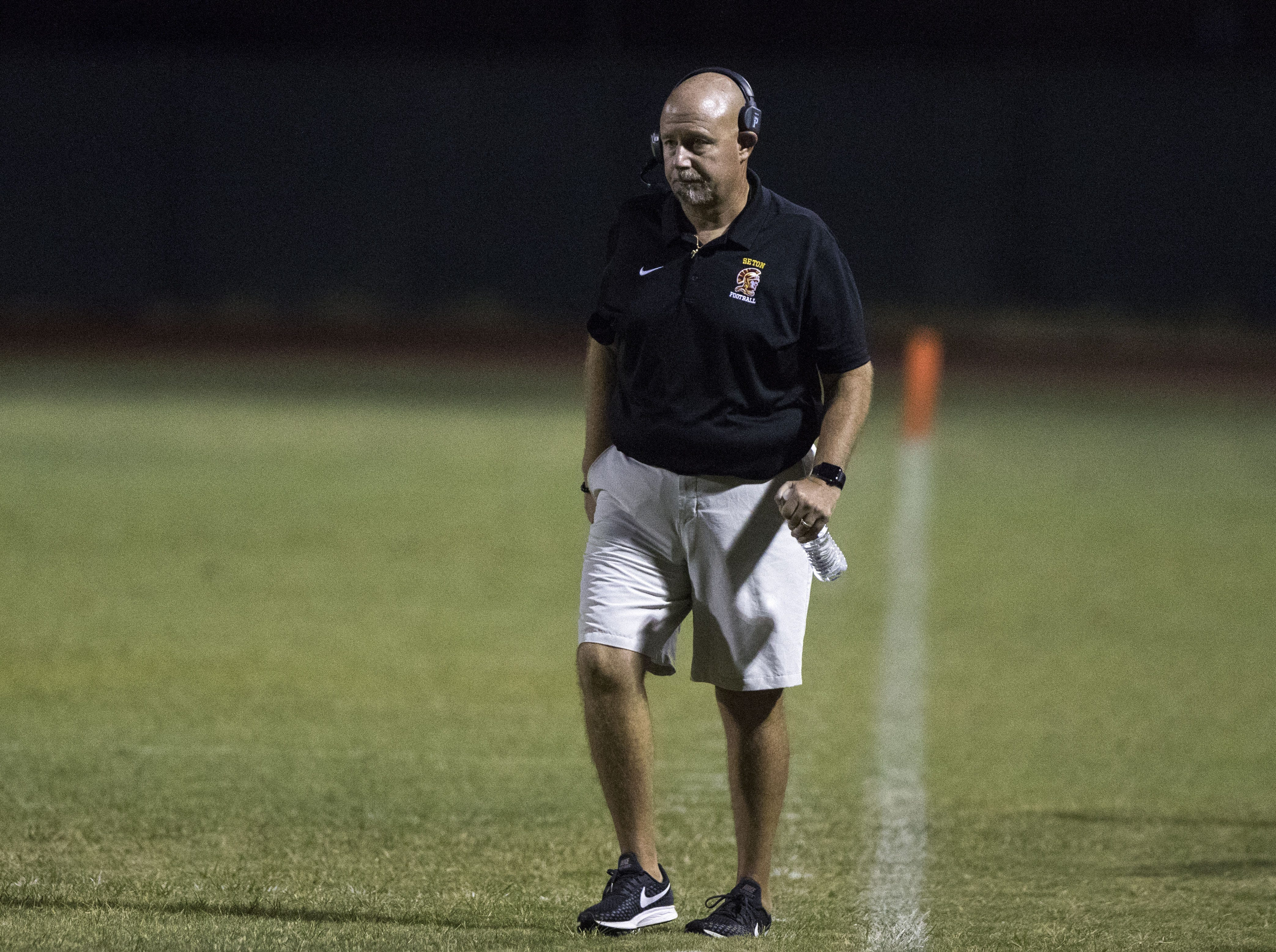 Seton coach Mike Chiurco walks the sideline during their game against Mesquite in Gilbert Friday, Sept. 21, 2018. #azhsfb