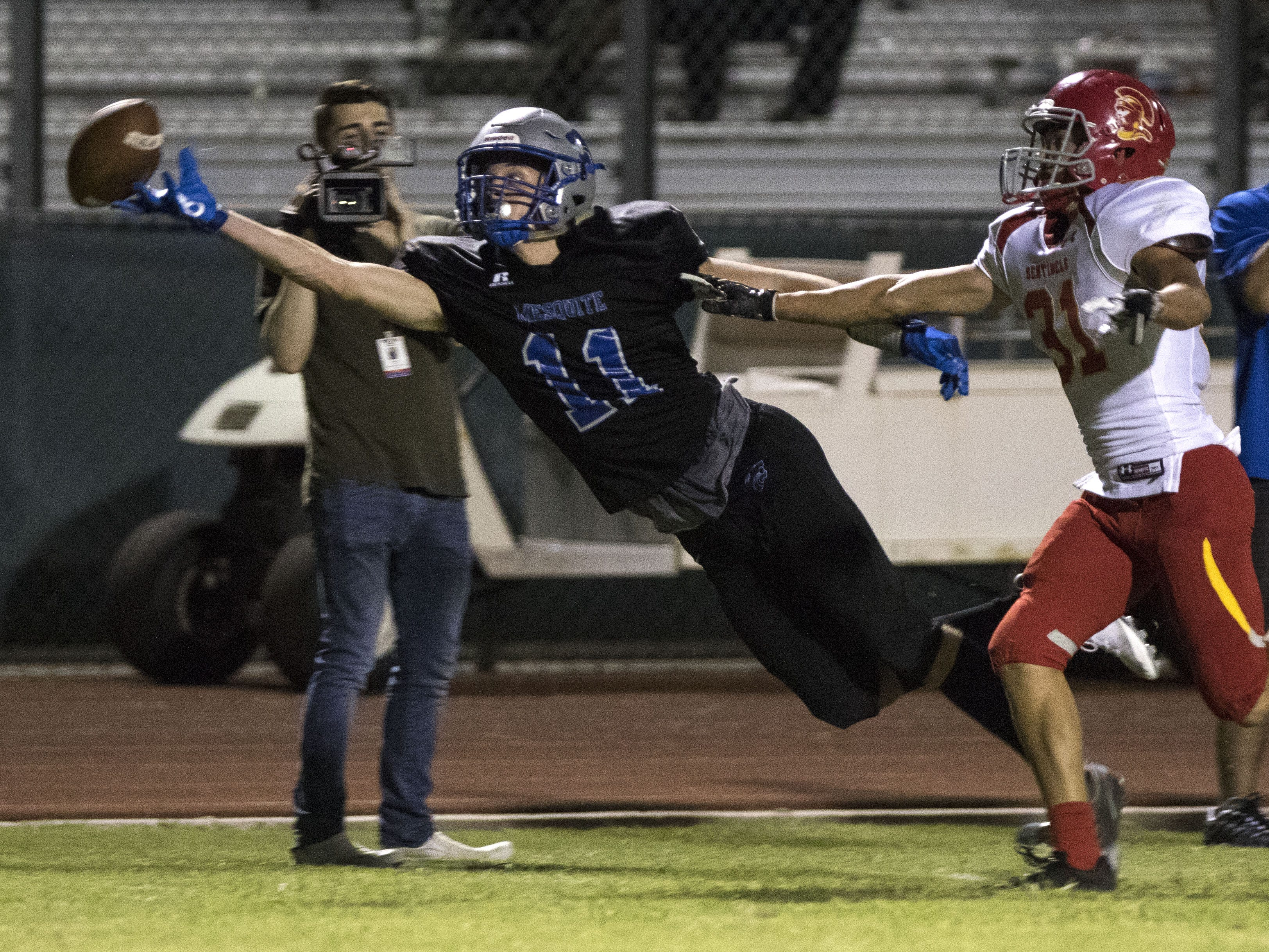 Mesquite's Jacob Walker has the ball on the edge of his fingertips but couldn't haul it in against Seton's Rube Woolsey during their game in Gilbert Friday, Sept. 21, 2018. #azhsfb