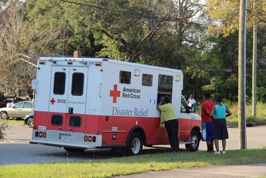 more than 3,900 people stayed in 59 Red Cross and community shelters in the Carolinas