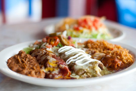 The restaurant's Elvis Presley Memorial Combo includes a beef enchilada, cheese enchilada, chicken enchilada, crispy taco and chips dipped in chile con queso.