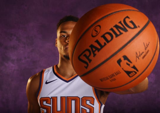 Suns rookie guard Eli Okobo poses during media day on Monday.