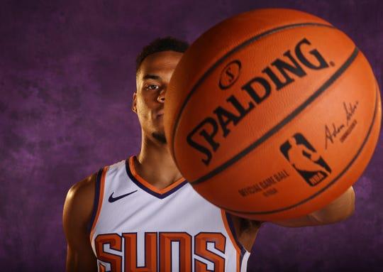 Suns rookie guard Eli Okobo poses during media day on Monday.