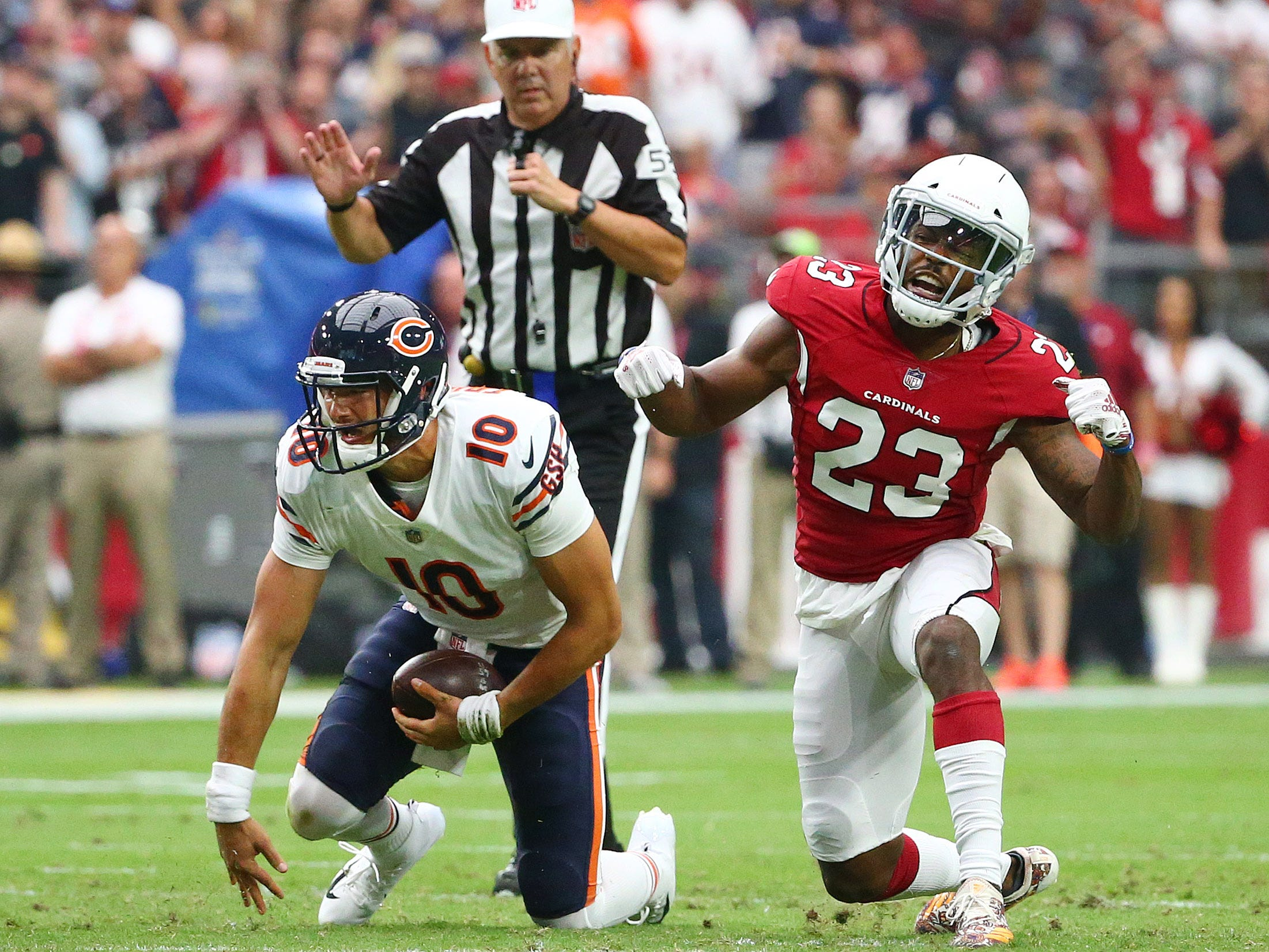 Arizona Cardinals cornerback Bene Benwikere sacks Chicago Bears quarterback Mitchell Trubisky in the first half at State Farm Stadium in Glendale, Ariz.