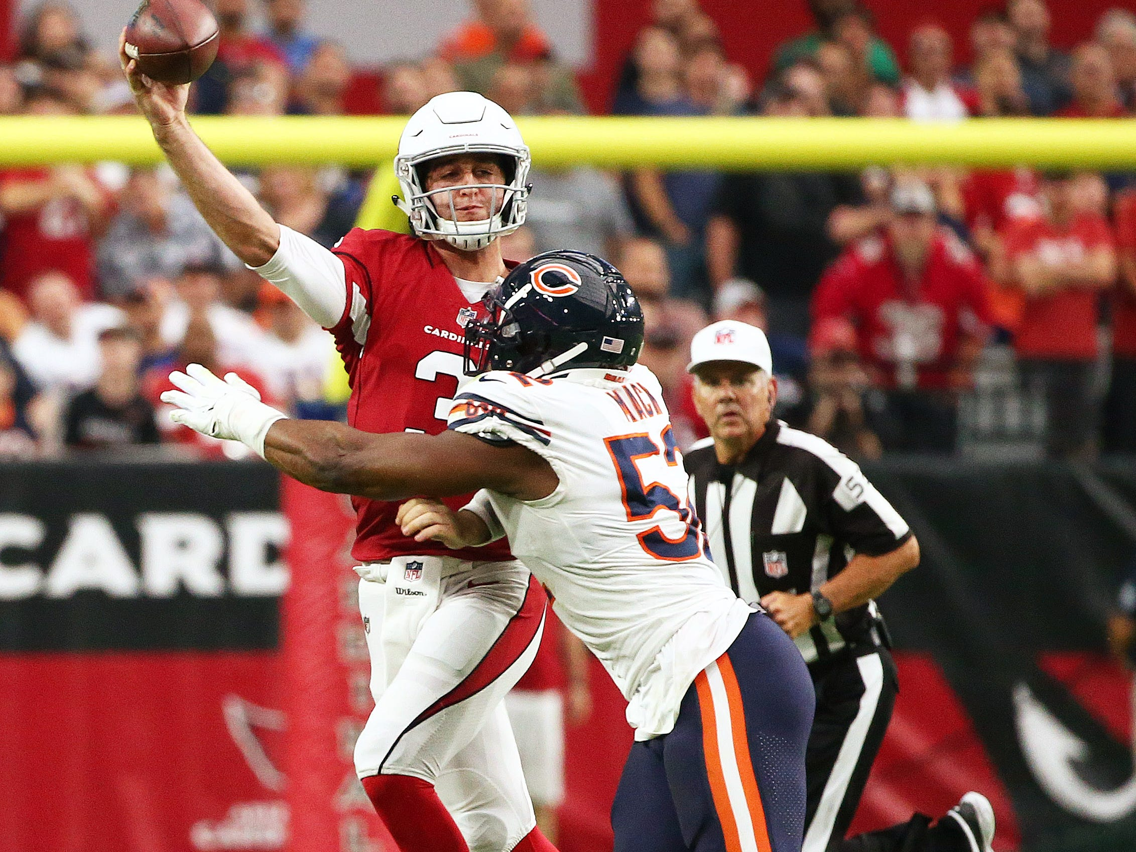 Arizona Cardinals quarterback Josh Rosen is hit by Chicago Bears Khalil Mack at State Farm Stadium in Glendale, Ariz.