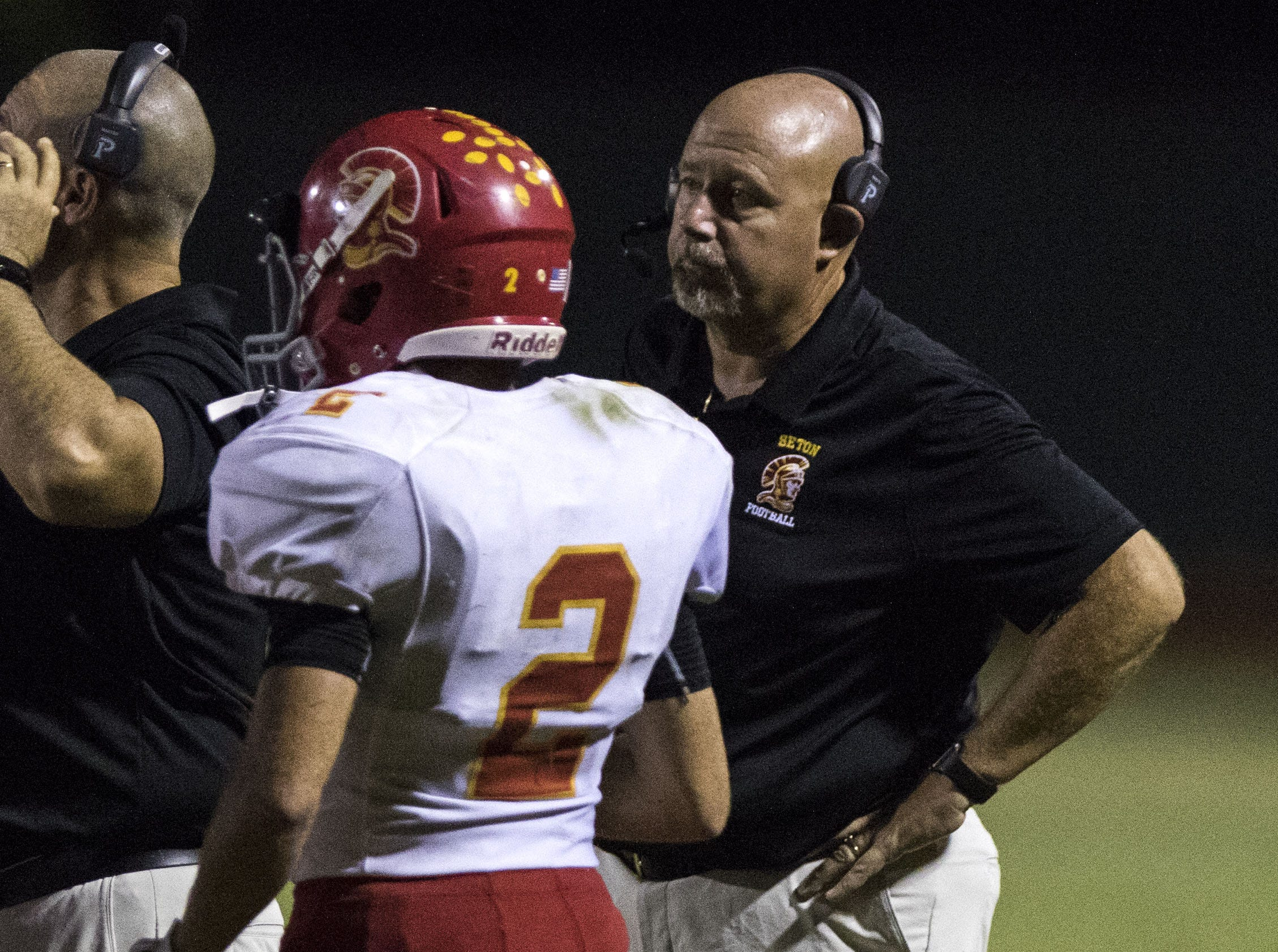 Seton coach Mike Chiurco listens in during their game against Mesquite in Gilbert Friday, Sept. 21, 2018. #azhsfb