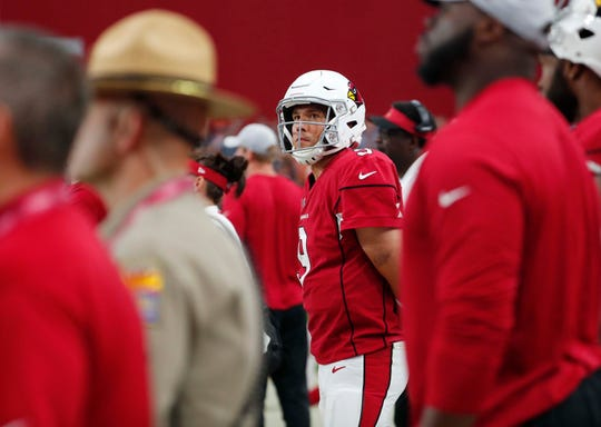 Arizona Cardinals quarterback Sam Bradford (9) watches the final minute of their 16-14 loss against the Chicago Bears during the fourth quarter at State Farm Stadium in Glendale, Ariz. September 23, 2018.