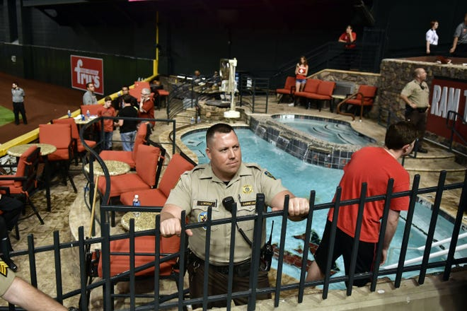 Oct 9, 2017: Police and venue security guard the pool area following the Los Angeles Dodgers victory against the Arizona Diamondbacks in Game 3 of the 2017 NLDS playoff baseball series at Chase Field.