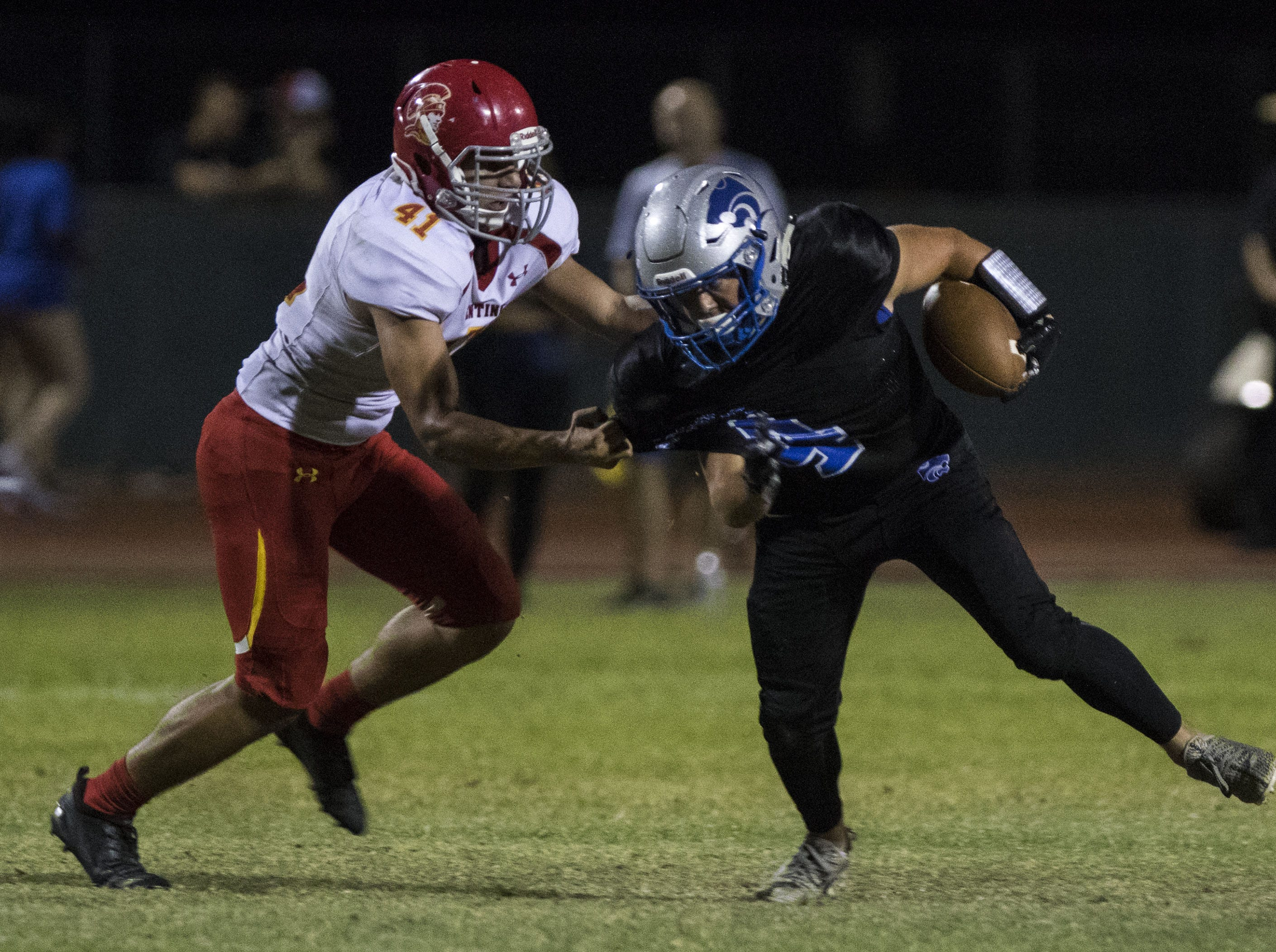 Seton's Dominic Pastore stops Mesquite's Chandler Coleman in the backfield during their game in Gilbert Friday, Sept. 21, 2018. #azhsfb