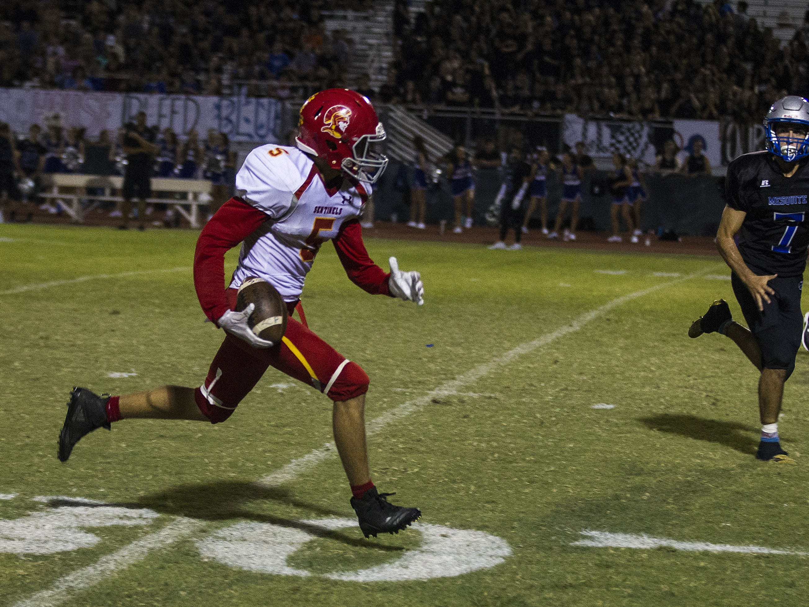 Seton's Colten Christiensen runs upfield against Mesquite's Jacob Henderson during their game in Gilbert Friday, Sept. 21, 2018. #azhsfb