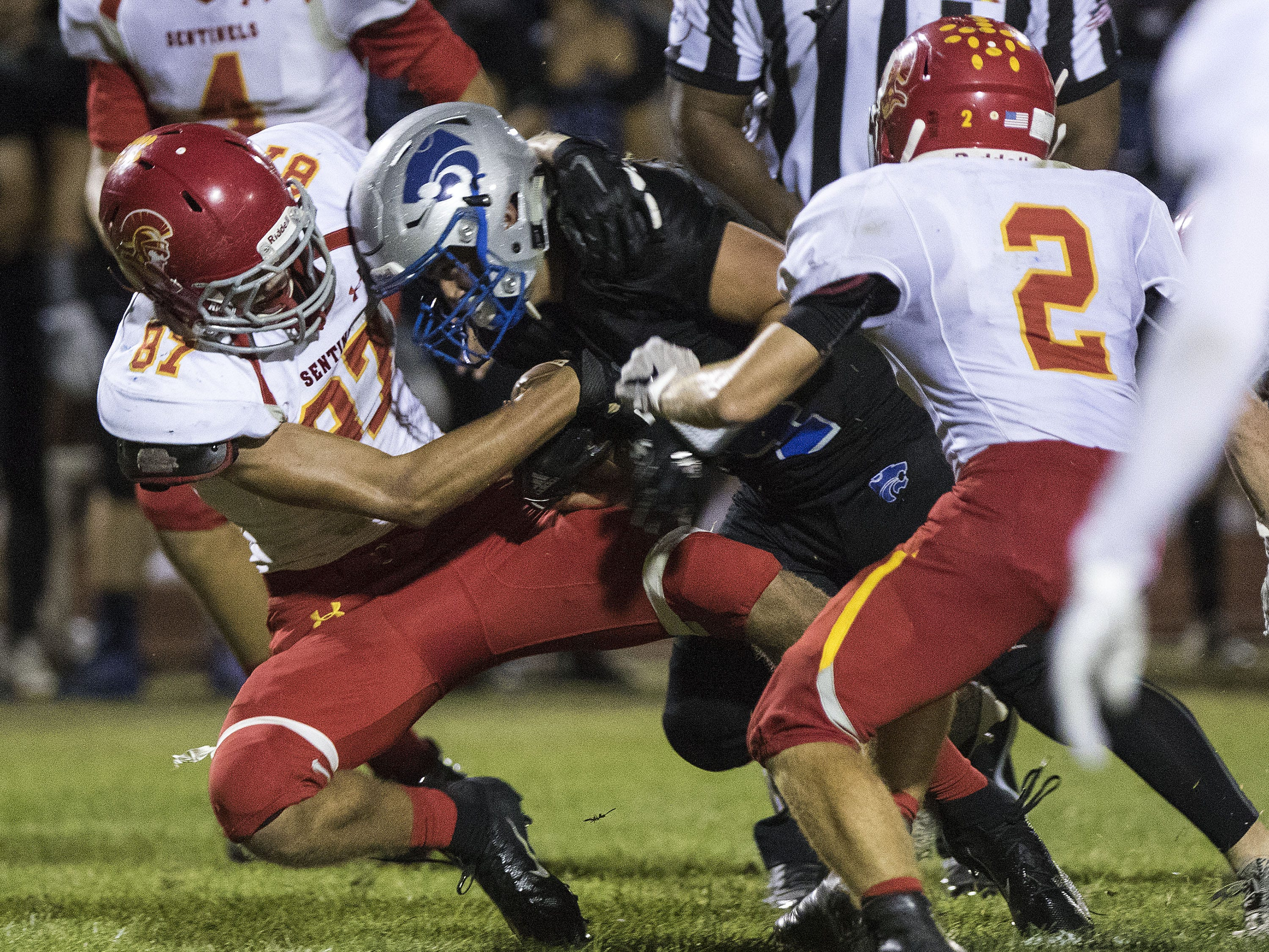 Seton's Josh Hansell wrestles Mesquite's Chandler Coleman down to the ground during their game in Gilbert Friday, Sept. 21, 2018. #azhsfb