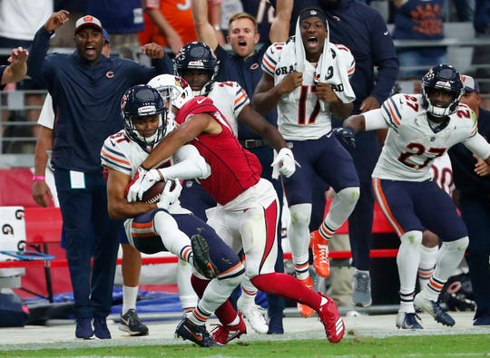 Bears defensive back Sherrick McManis intercepts a pass intended for Christian Kirk late in the fourth quarter of a game at State Farm Stadium.