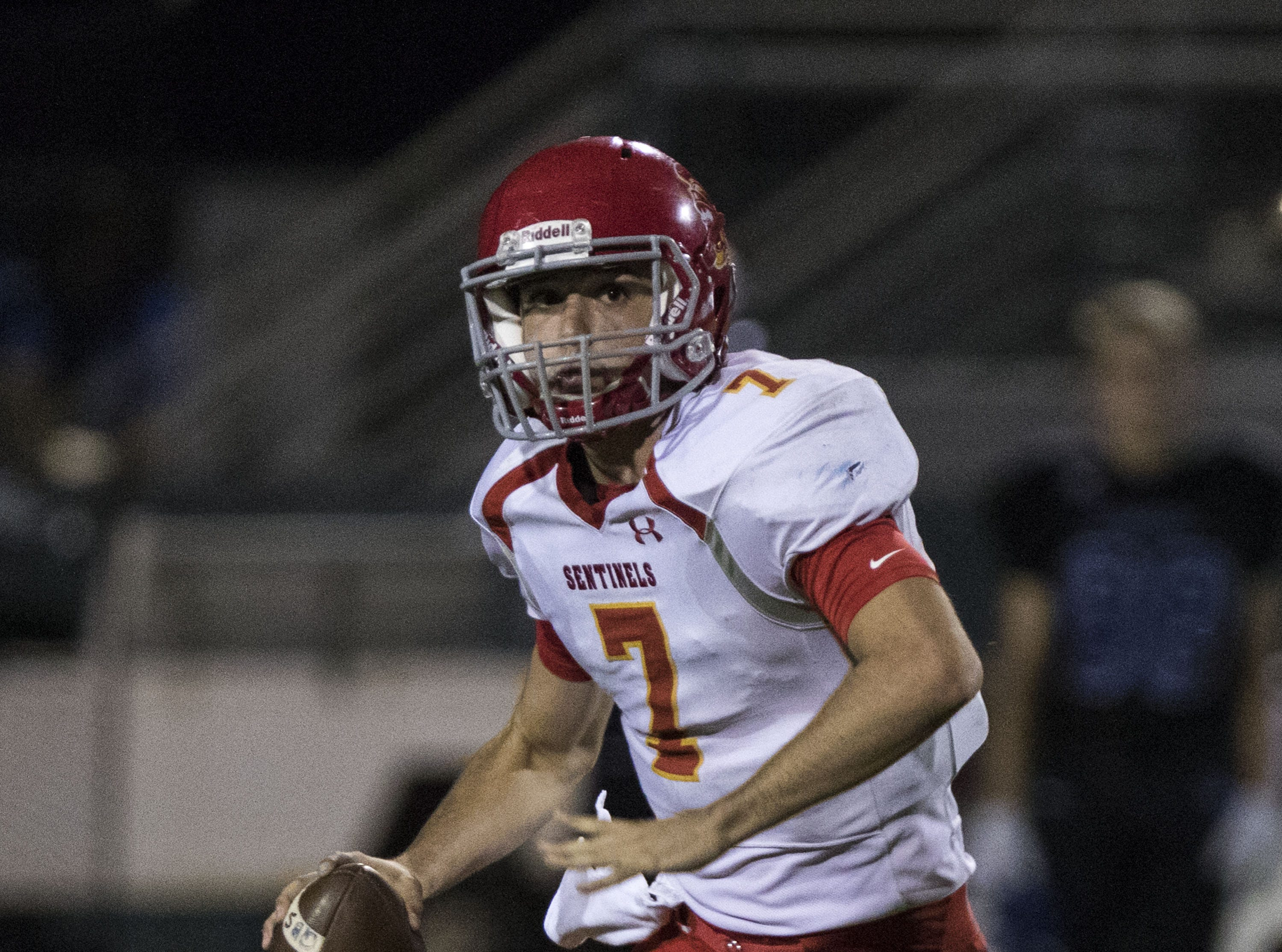 Seton's Vincent Wallace looks downfield for a receiver  during their game against Mesquite in Gilbert Friday, Sept. 21, 2018. #azhsfb