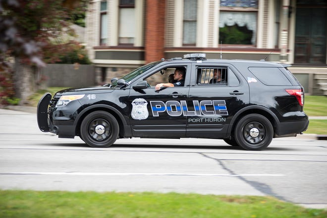 A Port Huron Police vehicle drives along Military Street Monday, Sept. 24, 2018. The number of violent crimes in Port Huron fell from 280 in 2016 to 264 in 2017.