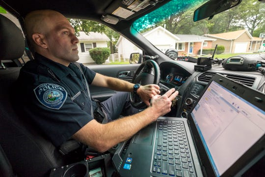 Port Huron Police Officer Nick Godwin responds to a trespassing report Monday, Sept. 24, 2018 in Port Huron.