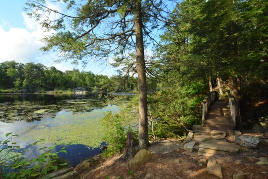 A small wooden bridge offers nice views of Pelton Pond in Hopewell Junction.