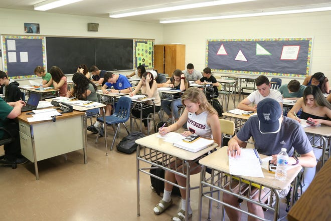 Students do work in a John Jay High School math class in May 2018.