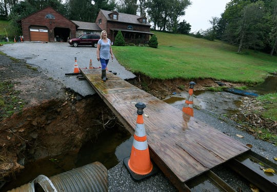 Stephanie Burns of Chanceford Township, calls daily to see if a disaster declaration has been issued in the wake of severe flooding across York County. The Burns family lost access to their home when their driveway was washed out by flooding and have been dealing with mold issues in their home. John A. Pavoncello photo