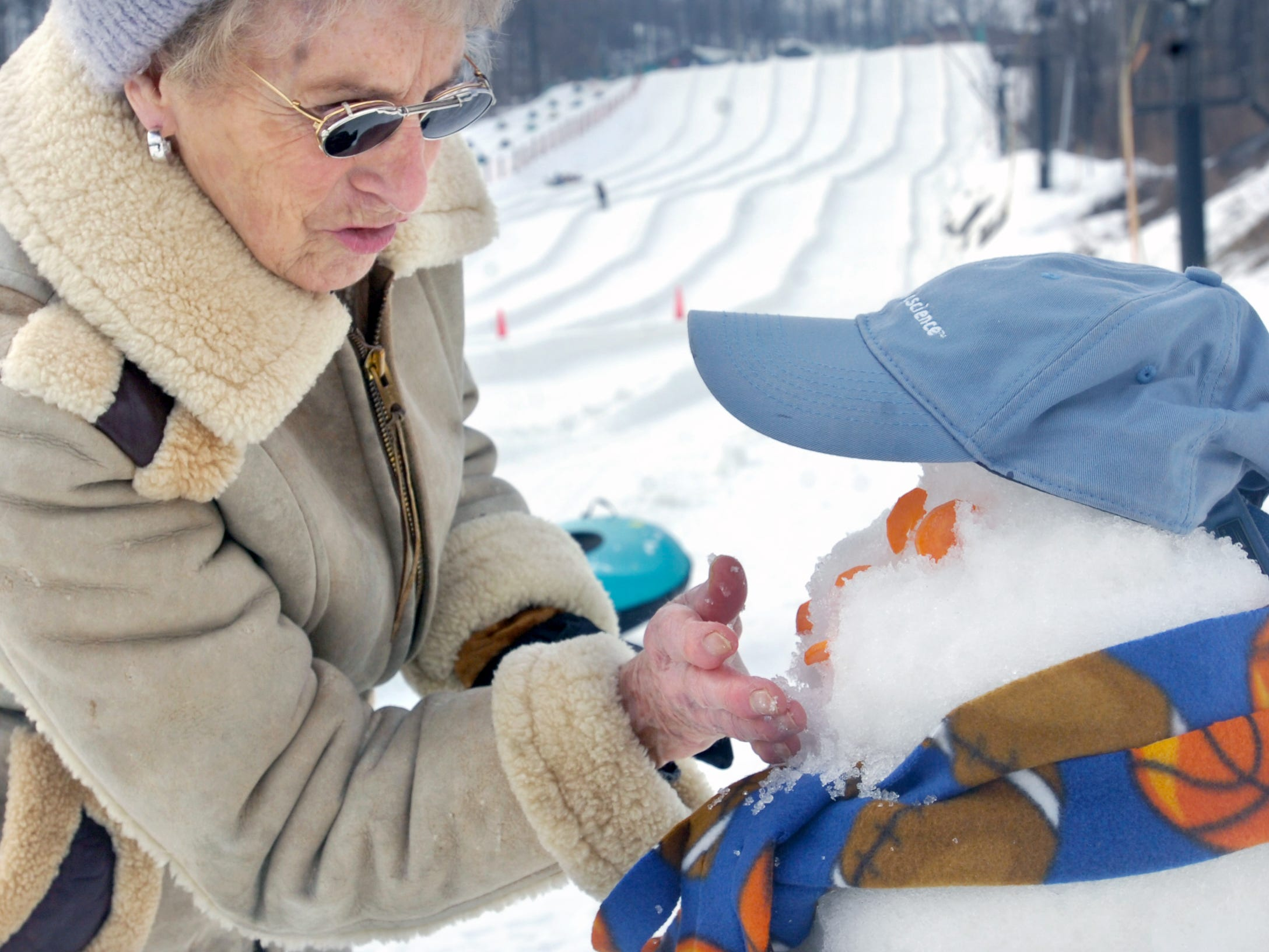 Janet Rankin of Woodcrest Villa in Lancaster builds a snowman for a competition during the event for seniors Monday at Ski Roundtop February 26, 2007. About 150 independent living residents from nine areas participated.