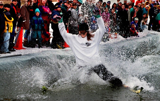 Stacy Speese skims with a split at Ski Roundtop January 17, 1996. The pond skimming on skis and snowboards was part of David Herth Memorial Spring Fest. The event benefitted the American Red Cross and Special Olympics. Peak Resorts, based in Wildwood, Mo., will acquire Snow Time for $76 million after it was owned by York-based Snow Time Inc. for 54 years.