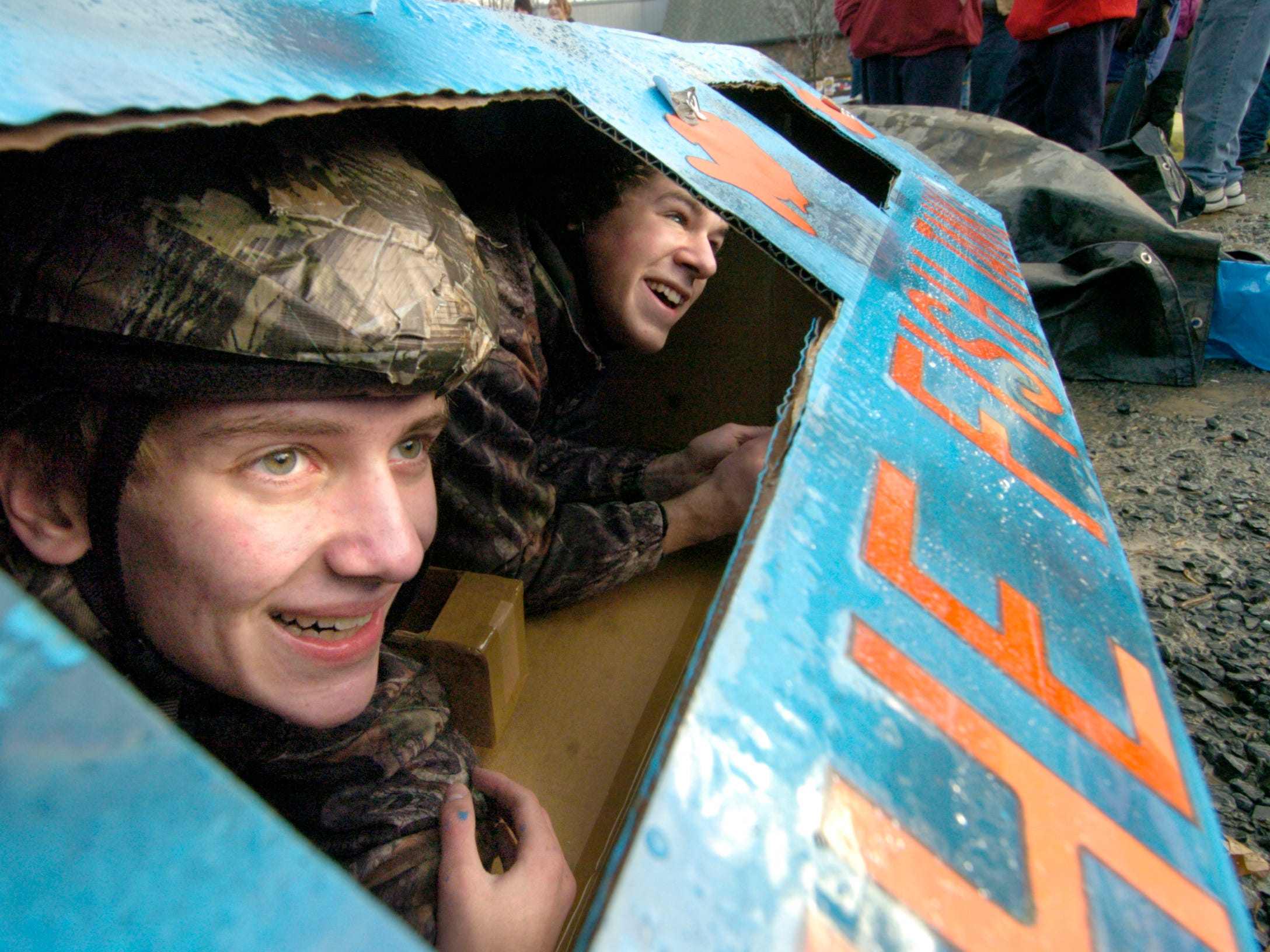 Justin Moore, 17, and Mike Keller, 17, look out of their Fish Tank vessel in the parking lot of Ski Roundtop before racing the tank down the tubing slope January 29, 2006. They spent roughly 40 hours, over 3 days, building the tank with their third teammate Andy Keller, 14.