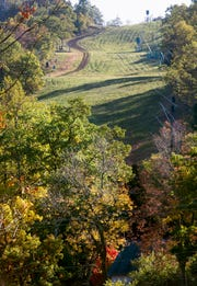 Just a spot of color leads the eye up a green ski slope Sunday at Roundtop Mountain Resort October 12, 2014.