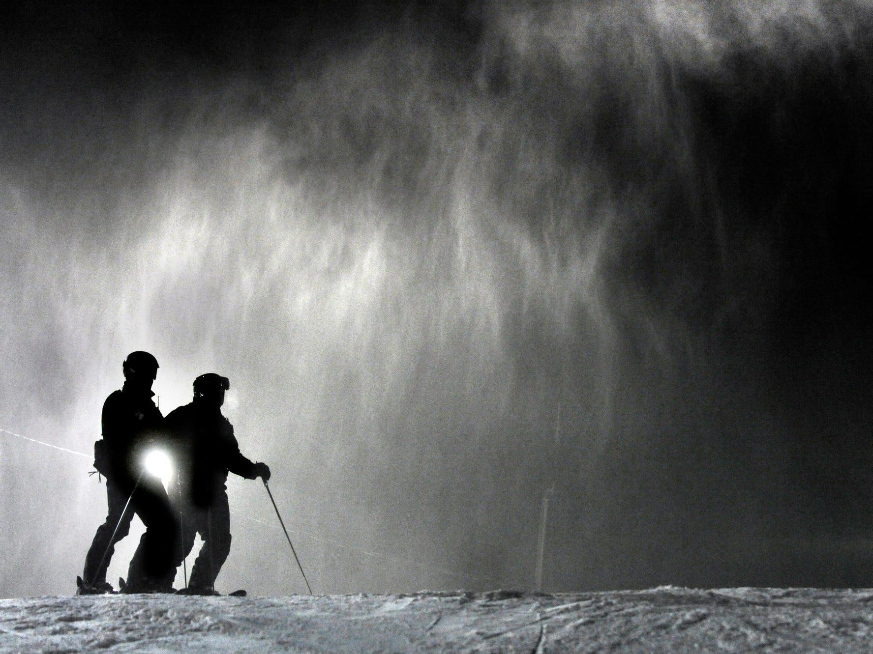 On top of one of the mountains fall ski patrolmen John Dickinson, left, and Curt Mullany before they descend at Roundtop Mountain Resort December 20, 2010.