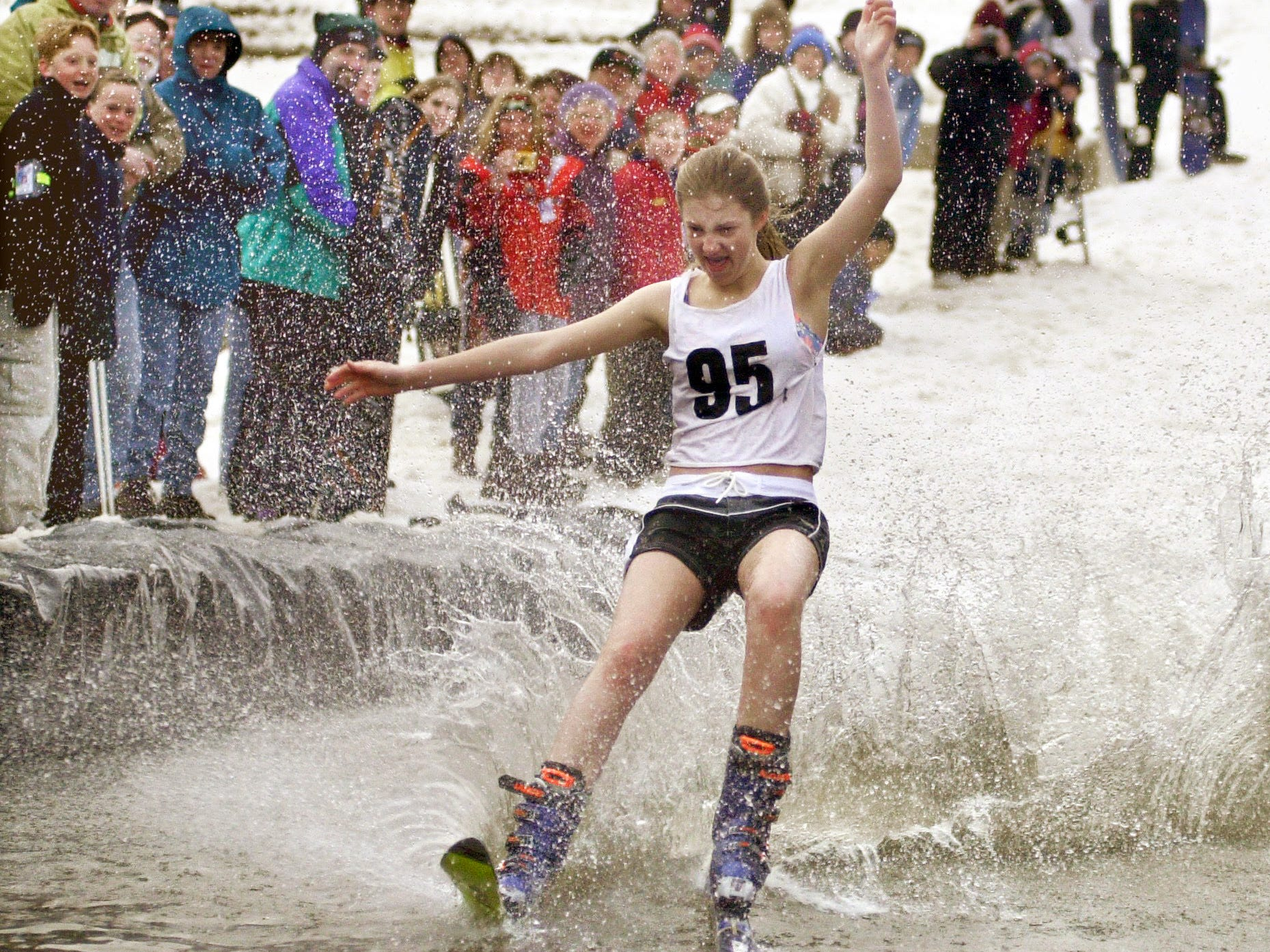 Jenna Yost, of York, Pa., makes it across the pond at Ski Roundtop near Lewisberry, Pa. on March 12, 2000, during the Pond Skimming contest. The contest was part of Roundtop's Spring Fest which included mountain bike races, a bikini downhill race, mogul competition and live music.
