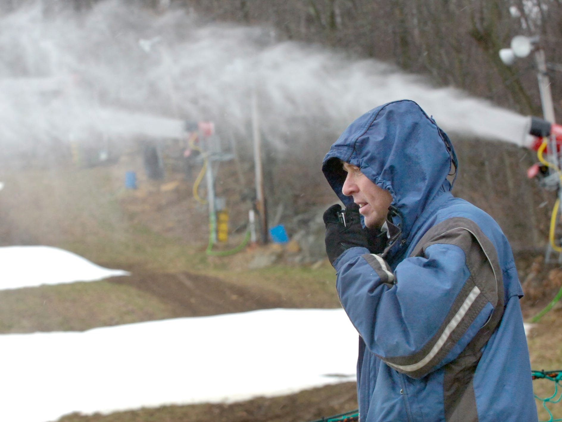 Jim Garling, mountain manager at Ski Roundtop, radios back to the computer operator about snow conditions as the snow guns fire up January 16, 2007. It was the first year Roundtop used computerized fan snow guns that helped save energy.
