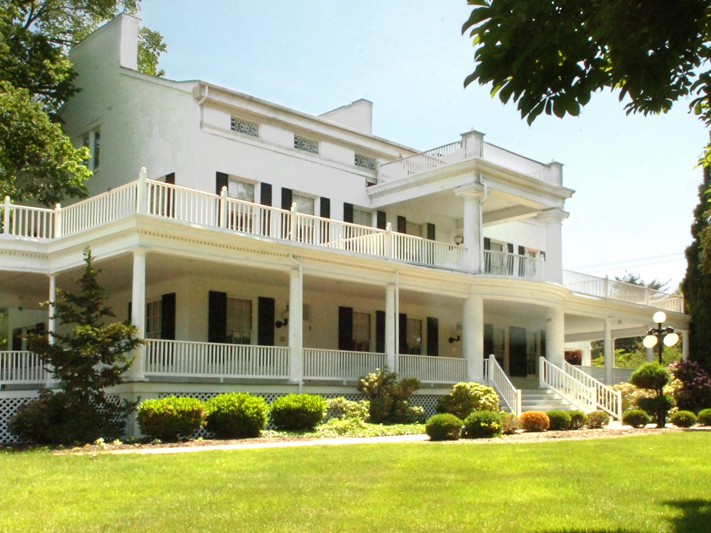 The historic Elmwood Mansion, as shown in a photo from 2007, is up for sale after being used for years as conference space and temporary housing for Memorial Hospital staff.