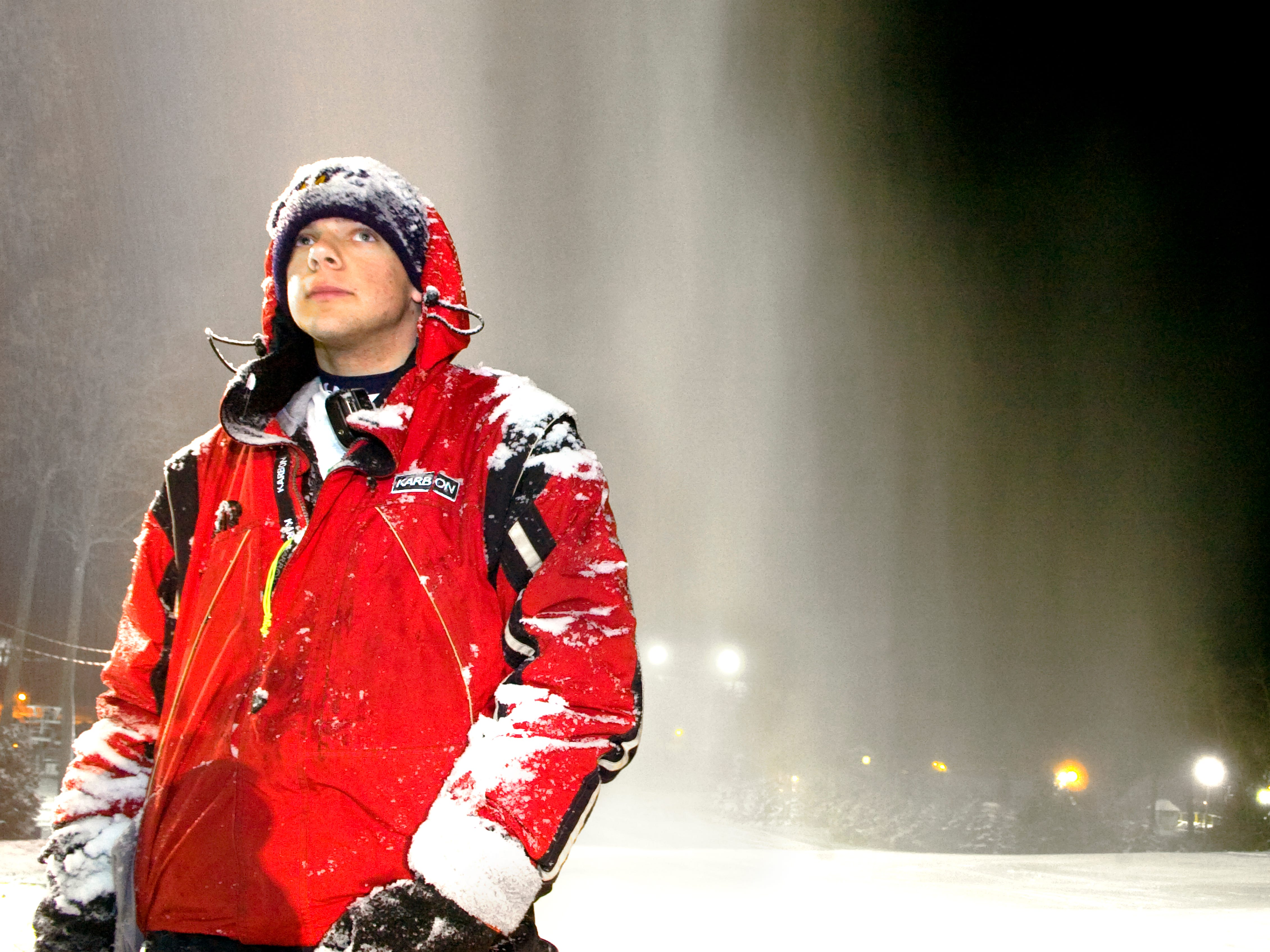 Covered in blown snow, Corey Bello watches where snow guns and fans will deposit snow at Ski Roundtop December 6, 2007. The newly made snow will be moved around in preparation for the slopes to open tonight. Bello is a student at York College and a full-time seasonal employee.
