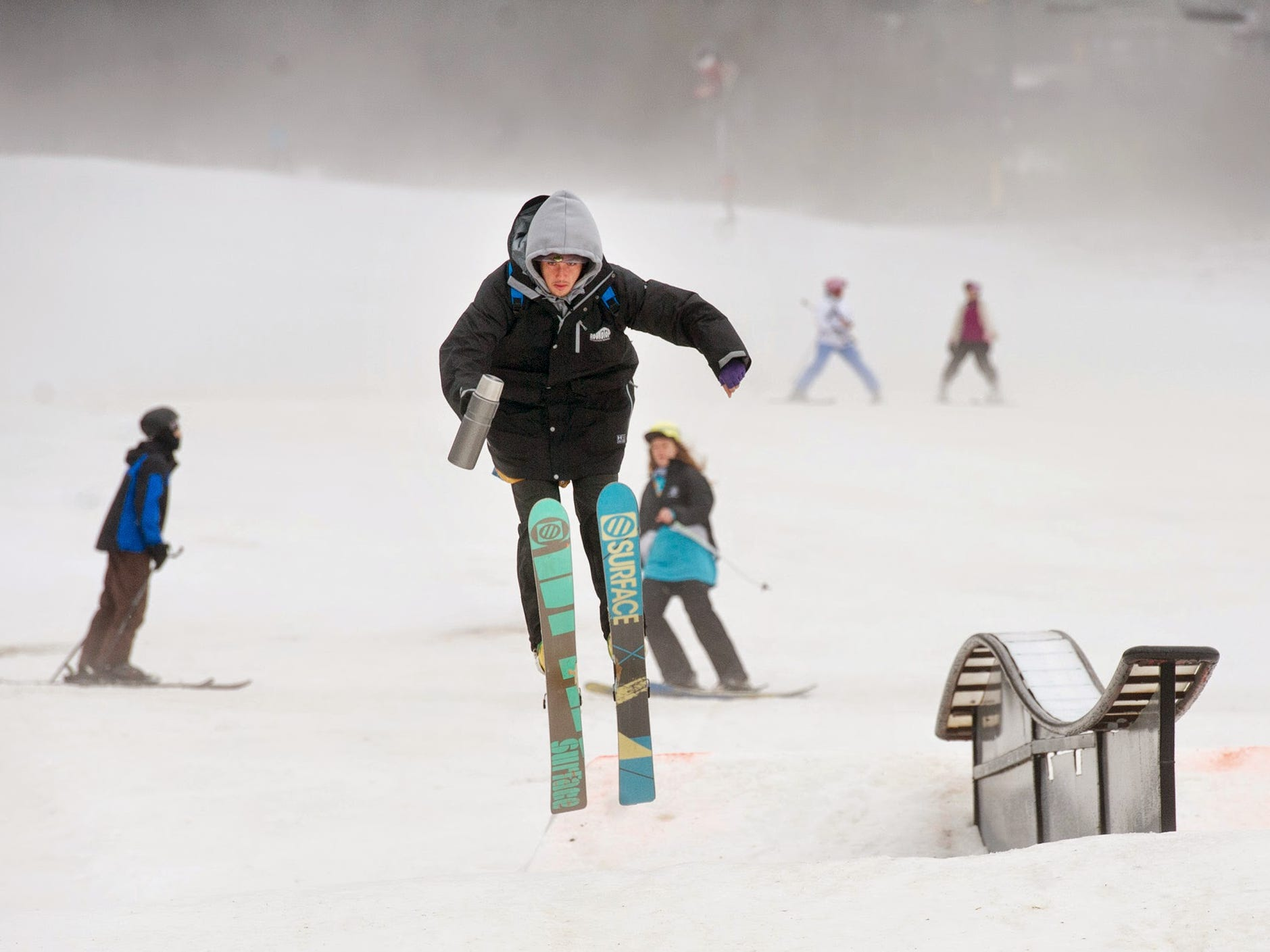 Fog hangs over cold snow from warm air and drizzle, but that didn't stop the skiing Sunday January 4, 2015 at Roundtop Mountain Resort in Warrington Township.