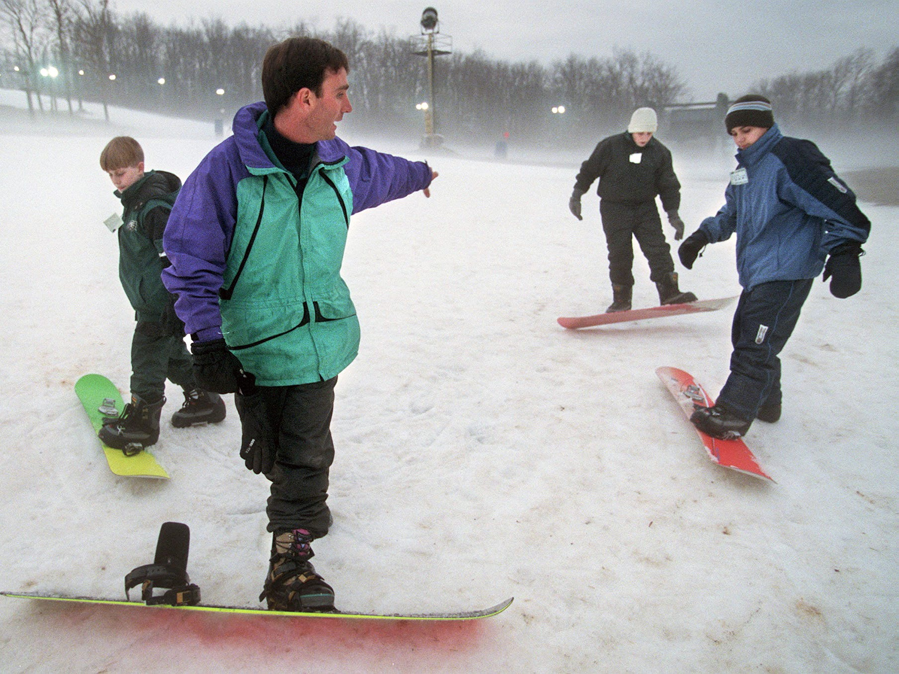 Ski School Instructor Vincent Farrell teaches snowboarders how to control their boards at Ski Roundtop on January 6, 1998.