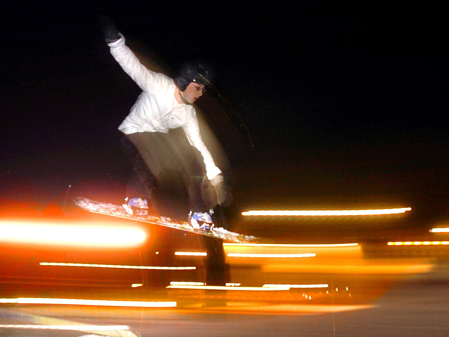 Instructor Alston Boyd flies over a rail while snowboarding  at Ski Roundtop February 16, 2006. Since the Winter Olympics began its run in Turin, Italy, the resort has seen plenty of activity from an increased interest in winter sports.