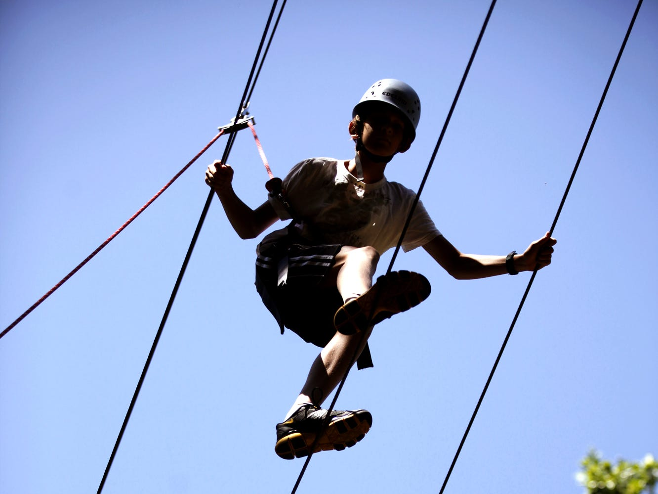 Simon Gorski, 12 of Harrisburg, does the cable walk at Roundtop Mountain Resort's high ropes course on Thursday, July 14, 2011.