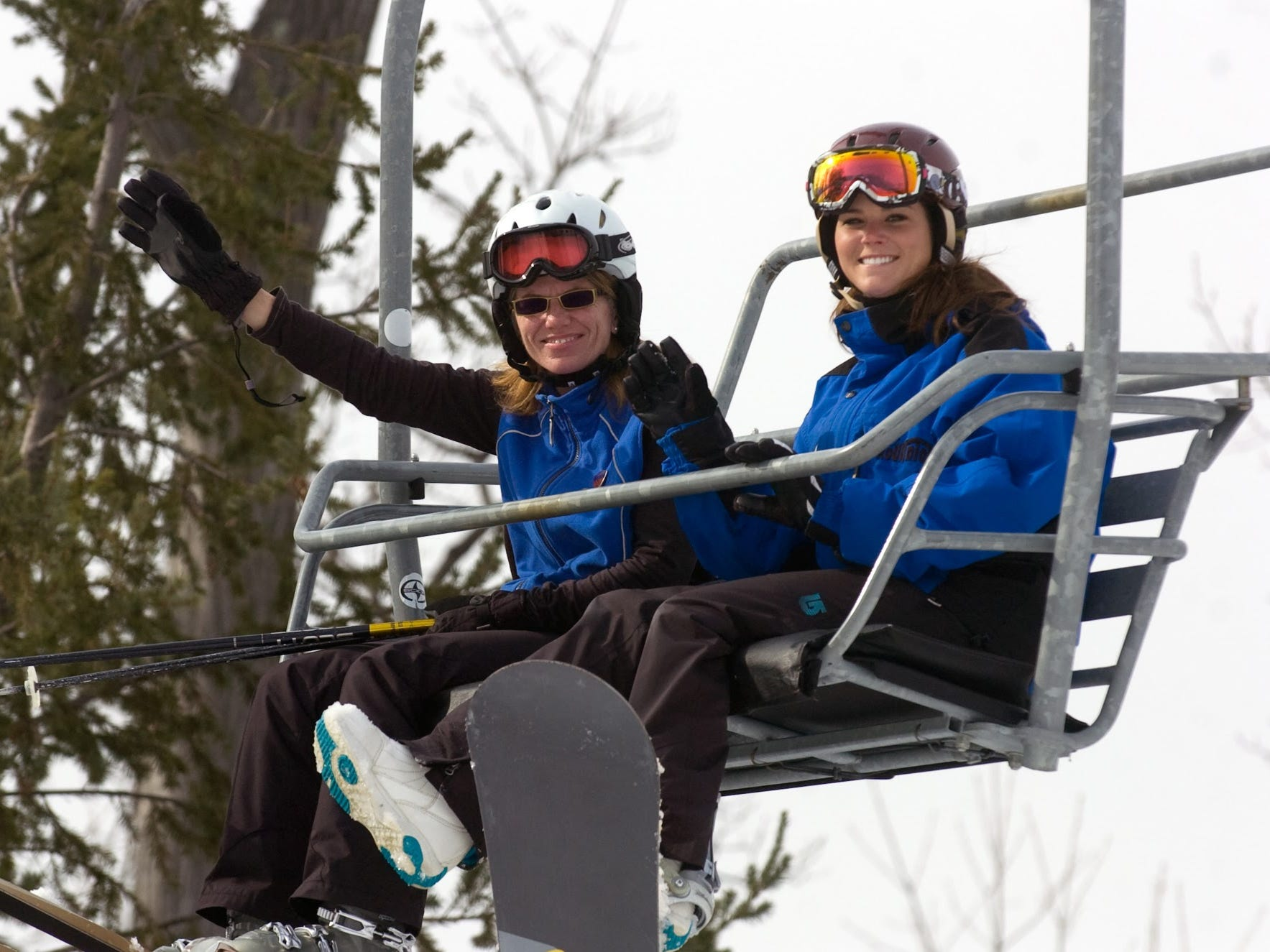 Rose Gavin, left, and Erica Culbert ride up the lift at Roundtop Mountain Resort March 11, 2011.