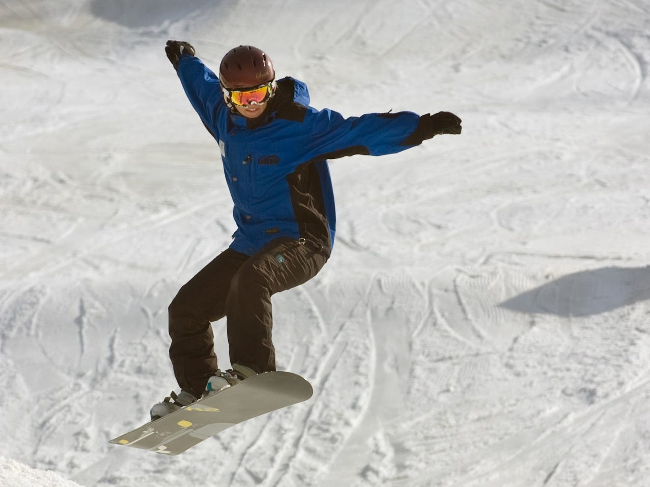 Instructor Erica Culbert, of Dillsburg, snow boards at Roundtop Mountain Resort Tuesday March 8, 2011.