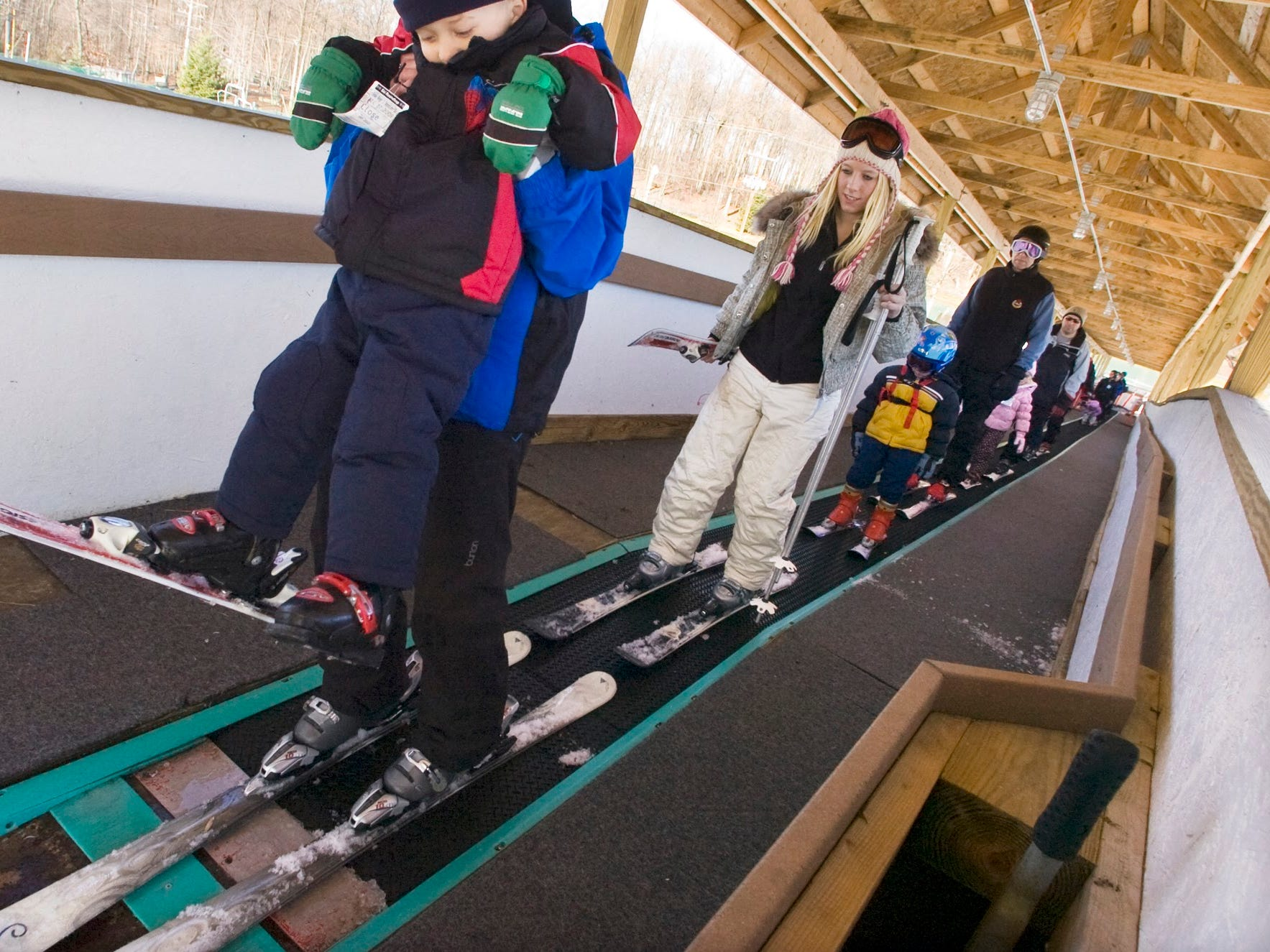 Dylan Sharpe, of Crofton, Md. gets a boost from a ski instructor at Ski Roundtop Sunday as he exits a lift the first time designed for beginners. Sharpe was taking his first ski class December 27, 2009.