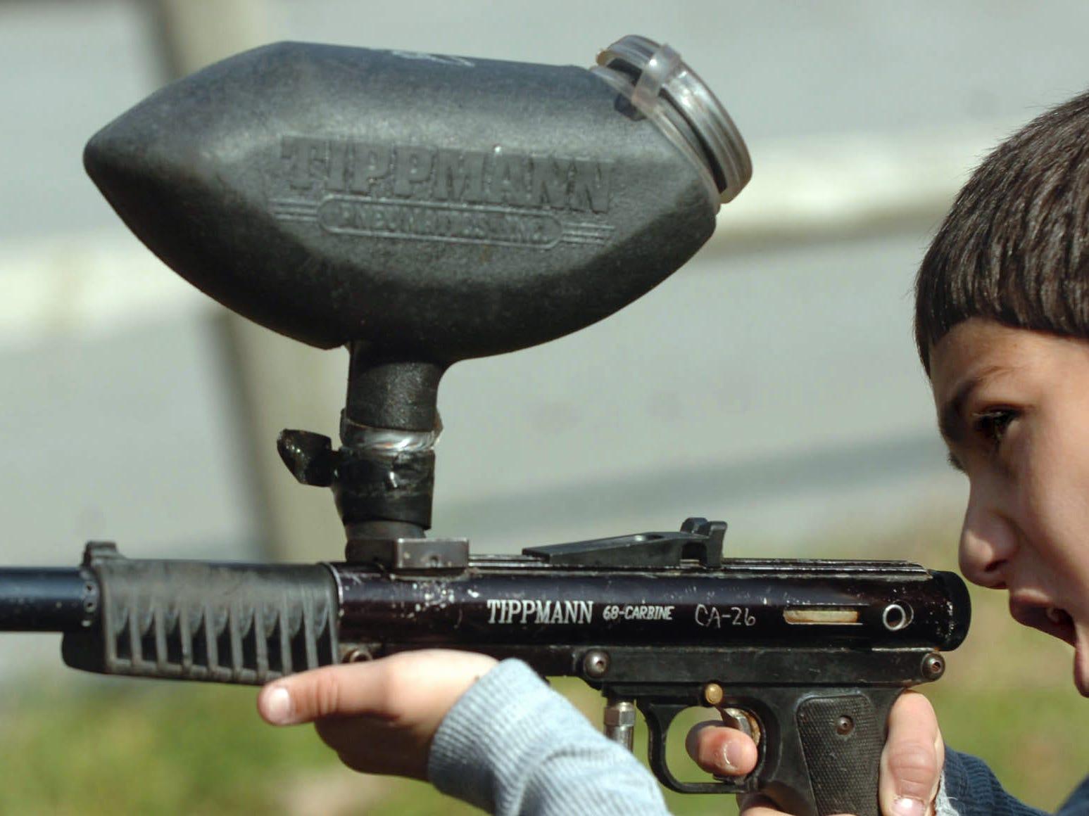 Misha Kushner, 9, of Harrisburg tried shooting a paintball gun Saturday during Ski Roundtop's Fall Extravaganza November 1, 2008.