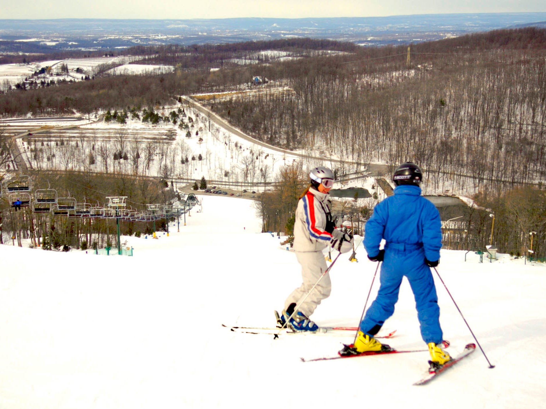 Gold medal-winning Olympian Diane Roffe helps a student with a ski lesson from the top of Ski Roundtop March 2, 2005.