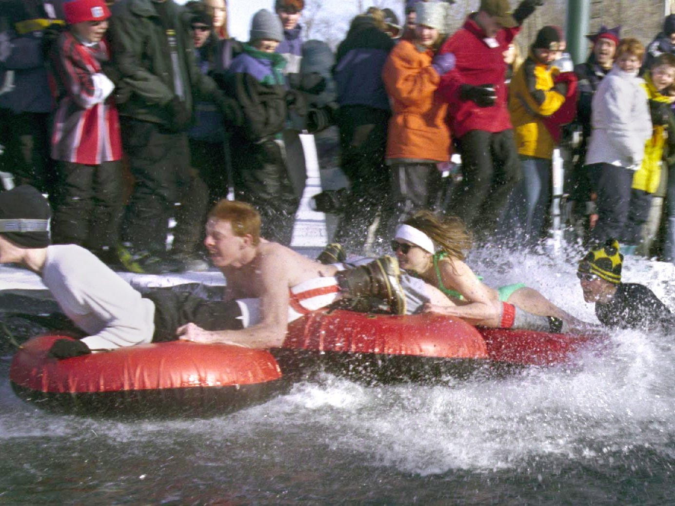 Temperatures of 28 degrees and a brisk wind didn't keep bathing suit clad people from competing in the Pond Skimming contest at Ski Roundtop on March 7, 1999 during the Subaru Spring Fest.