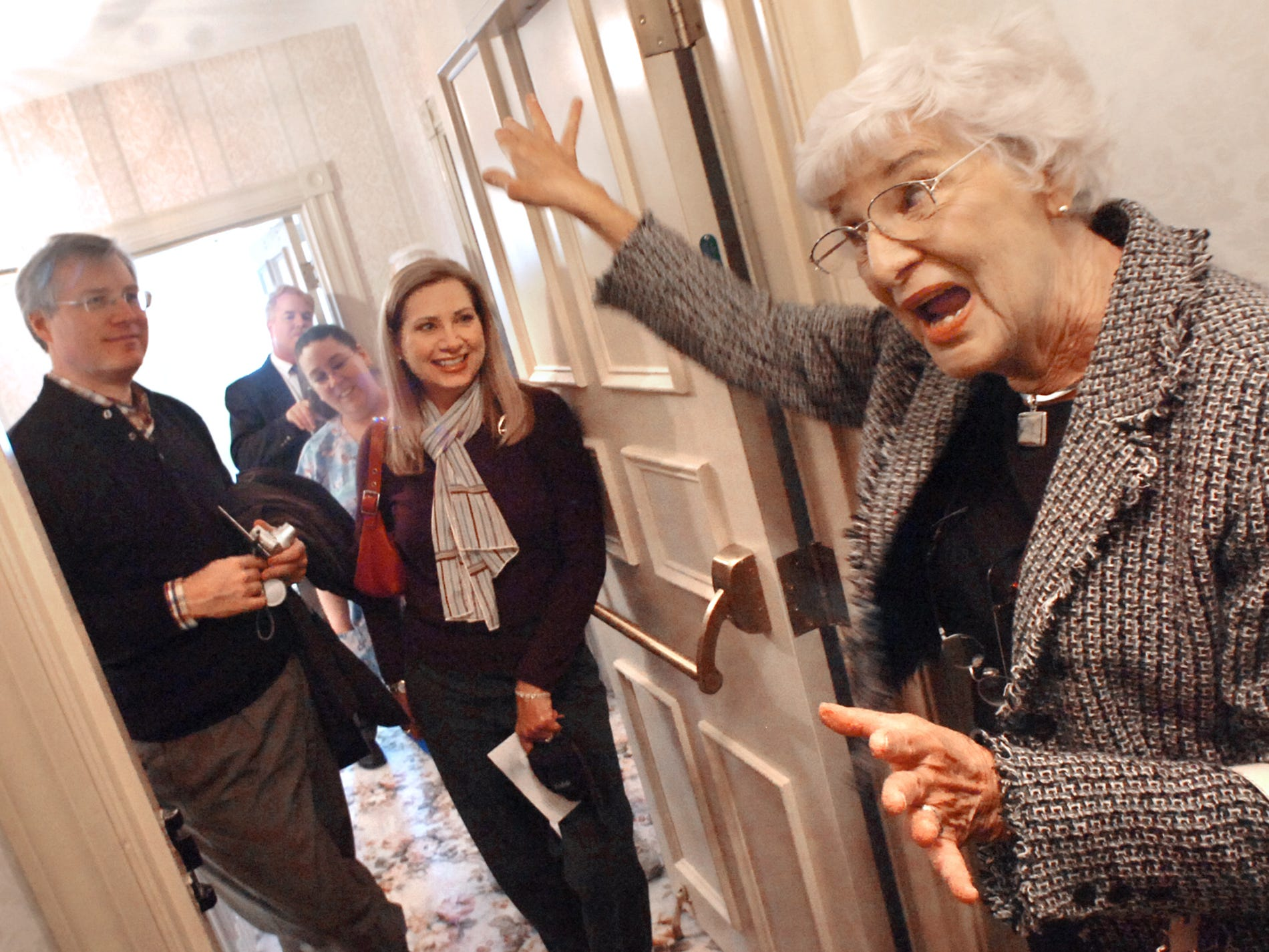 Robert Paul Niess, left, and Linda Tartak watch in 2007 as their mother, Ann Small Niess, right, talks about the ghosts that she said lived in her old house. Niess' family, a friend and others toured the Elmwood Mansion, which is now owned by Memorial Hospital.