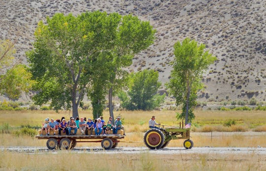 Ken Wellnitz, of Yerington, drives his tractor and provides hayrides throughout the park to visitors.