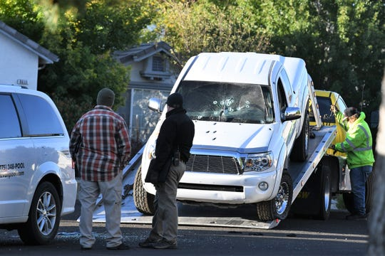 A white pickup truck is loaded onto a tow truck at the scene of a shooting where one man was shot by Reno Police Department officers in Stead on Sunday, Sept. 23.