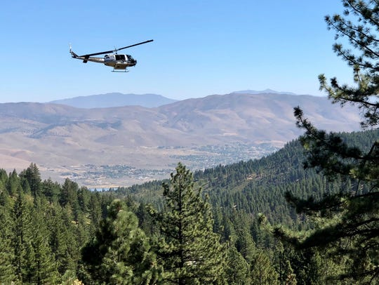 The Washoe County Sheriff's Office RAVEN helicopter searches for Madelyn Lingenfelter, 19, on Mt. Rose on Sept. 23, 2018.